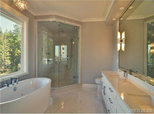 main bath with scenic window views as you soak in tub or shower, BC
